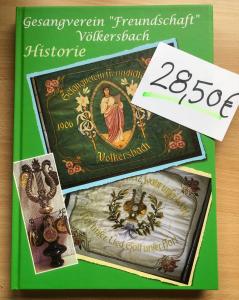 Fotografie des Covers der Vereinschronik des Gesangverein Freundschaft Völkersbach sowie einem Preisschild mit dem Preis 28,50€